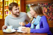 Couple talking in cafe — Stock Photo