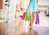 Legs of attractive shopaholic woman — Stock Photo