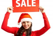 Woman in Santa cap inviting you for sale — Stock Photo