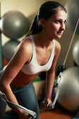 Woman exercising with plate load machine — Stock Photo