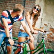 Couple riding on bicycles — Stock Photo #61780633