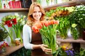 Florist with tulips — Stock Photo