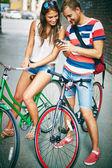 Bicyclists using cellphone — Stok fotoğraf