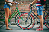Guy and girl legs with bicycles — Stock Photo
