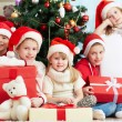 Friends by Christmas tree — Stock Photo #62857119