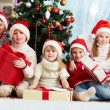Friends by Christmas tree — Stock Photo #62857125
