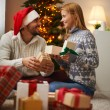 Couple opening Christmas presents — Stock Photo #62858787