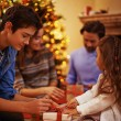 Children opening Christmas presents — Stock Photo #62858797