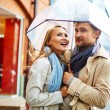 Couple walking under umbrella — Stock Photo #62859729