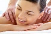 Happy woman enjoying massage — Stockfoto