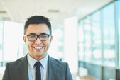 Businessman with toothy smile — Stock Photo