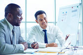 Business colleagues discussing points — Stock Photo