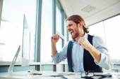 Ecstatic young businessman — Stock Photo