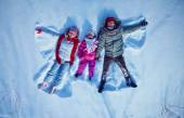 Family having fun in snowdrift — Stock Photo