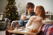 Couple having tea with cupcakes — Foto de Stock