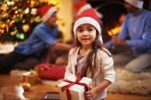 Girl in Santa cap with giftbox — Stock Photo