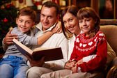 Family reading interesting tales — Stock Photo