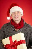 Santa man holding big giftbox — Stock Photo