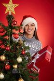 Woman in Santa cap — Stock Photo