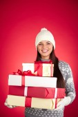 Girl in winterwear holding heap of packages — Stock Photo