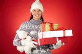 Woman holding gifts and teddy bear — Stock Photo
