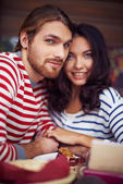 Amorous dates sitting in cafe — Stock Photo