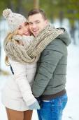 Amorous couple in winter park — Stock Photo