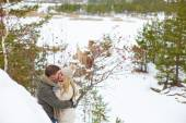 Couple having date in winter park — 图库照片