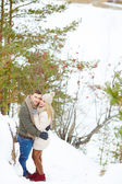 Couple embracing in winter forest — Stock Photo