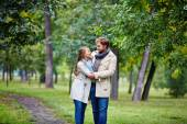 Amorous couple in summer park — Stock Photo
