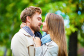 Couple looking at one another in embrace — Stock Photo