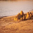 Sand castle on beach — Stockfoto #62862919