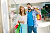 Consumers shopping in mall — Stock Photo