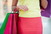 Woman  customer  carrying colorful paperbags — Stock Photo