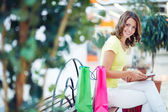 Shopper woman using digital tablet — Stock Photo