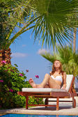 Woman sunbathing on deckchair — Stock Photo