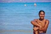 Man resting on sandy seashore — Stock Photo