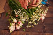 Florist with bunch of flowers — Stock Photo