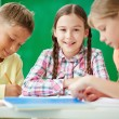 Schoolkids at drawing lesson — Stock Photo #63889131