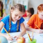 Schoolgirls at drawing lesson — Foto de Stock   #63889243