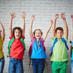 Ecstatic pupils with backpacks — Foto de Stock   #63889249