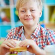 Happy schoolboy with sandwich — Stock Photo #63889357