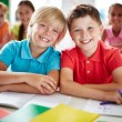 Cheerful schoolboys in classroom — Stock Photo #63889359