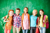 Group of pupils with backpacks — Stock Photo