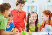 Friendly chat schoolkids — Stock Photo