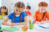 Schoolgirls drawing at lesson — Stock Photo