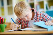 Learner cheating at lesson — Stock Photo