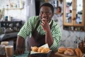 Young Vendor of buns — Stock Photo