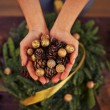 Hands with fir-cones and  balls — Stock Photo #63895241