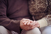 Hands of devoted seniors — Stock Photo